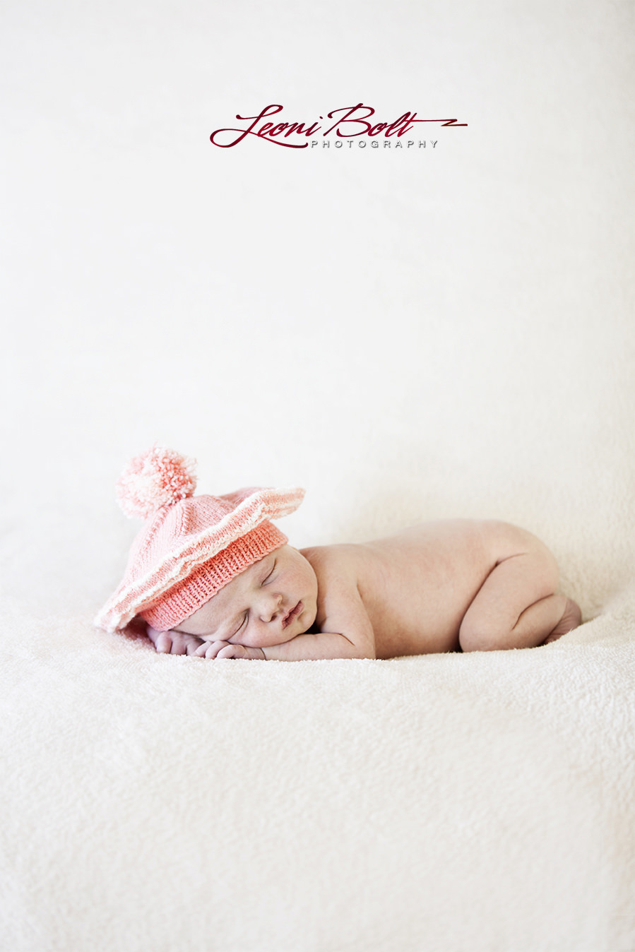 newborn in a hat