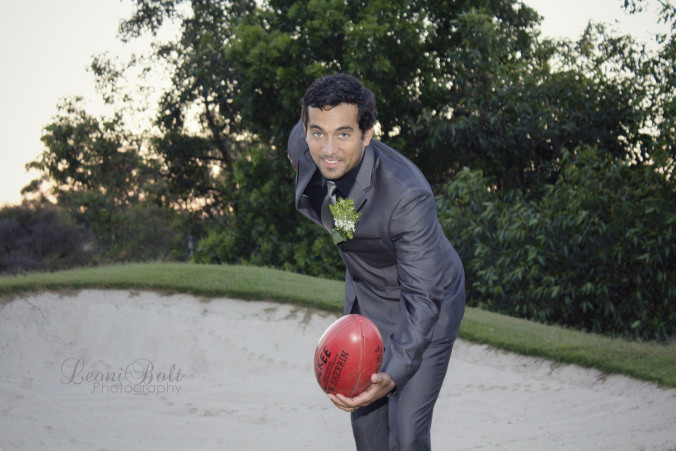 groom with AFL football