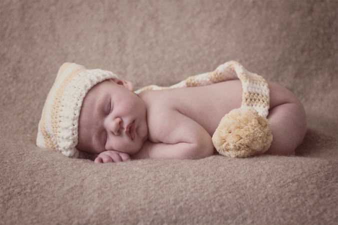 newborn in a pixie hat