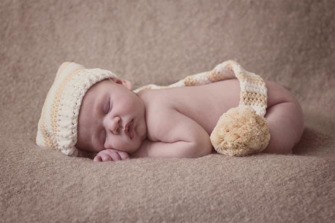 newborn in a pixie hat